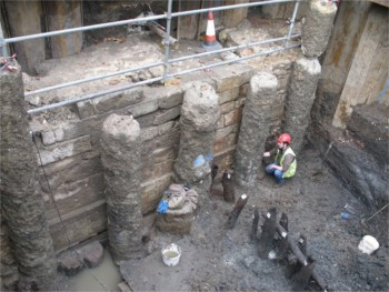 The Tudor masonry river wall and thirteenth-century timbers in the course of excavation in Black Rod's Garden. © Parliamentary Estates Directorate Archive.